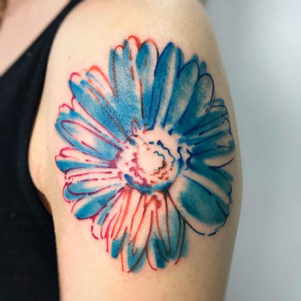 Tatuaggio acquerello margherita Wharol fiore spalla